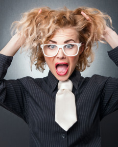 Shocked young business woman with expression face , isolated on gray